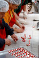 (DENVER , Colo., December 6, 2004)   Workers at Hammond's Candies make candy canes Monday, Dec. 6,...