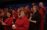 (ARVADA, Colo., December 2, 2004) Kathy Tiazza, closest with red shirt, red short hair, glasses,...
