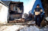 (Denver, Co. - Shot 12/2/2004) Peter Middlebrook of Denver turns to leave Thursday after looking...