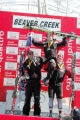 Bode Miller (left) shares the winners podium with Austrians Stephan Goergl (center) and Mario...