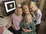 Centennial, Colorado.  December 17, 2004.  Stay-at-home rocket scientist Laura Ellen Dafoe with...