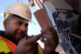 (FORT COLLINS, Colo., December 16, 2004)  Comcast technician Jimmy Chacon hooks up new service to...