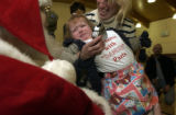(DENVER, Colo., December 14, 2004) Margaret Hecox, 18 months, with her mom Shawn was a first timer...