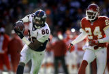 (KANSAS CITY, Mo., SHOT 12/19/2004) The Denver Broncos' Rod Smith (#80, WR) hauls in a touchdown...