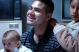 (MEXICO CITY, MEXICO DECEMBER 16, 2004) (Lt. to Rt.) Six-month-old Bryan Montes, is held by his...