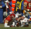[(Kansas City, MO, Shot on: 12/19/04)] Denver Broncos Jeb Putzier gets upended by Kansas City...