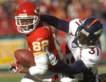 [(Kansas City, MO, Shot on: 12/19/04)] Denver Broncos Kelly Herndon(right) brings down Kansas City...