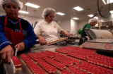 (DENVER , Colo., December 6, 2004)   Workers at Hammond's Candies make ribbon candy at the plant...