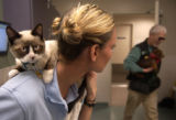 [DENVER*, CO - Shot on: 12/21/04] Deanne Thompson holds Sasha, a four-month old female Himalayan,...