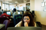 (DENVER, Colo., Dec. 7, 2004) Christine Cardenas, of Denver looks for a administration jobs on the...