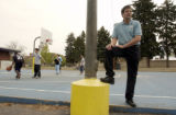 (DENVER, Colo., April 28, 2004) Pastor Michael Walker, Church in the City, on the basketball court...
