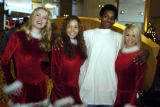 12/07/2004 Denver-Schuyler Graves, 15, Denver, has a photo taken with members of the Denver...