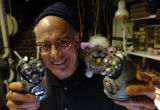 (DENVER, CO., DECEMBER 20, 2004)  Artist and Metalist, Ira Sherman holds a few of his toy...