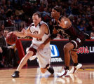 [Denver , CO - Shot on: 1/21/05-University of Denver  guard, Erik Benzel (left), drives past...