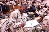 (FORT CARSON, Colo., Dec. 8, 2004) 1LT, Antoine Rhodes, California, from the 59th Quarter Masters,...