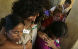 (1/26/05, Pondicherry, India) Gomthi, Zenia Tata, S. Shanthi hug and say a final prayer after the...