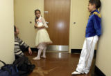 (DENVER, Colo., December 8, 2004) Margarita Ramirez watches her daughter Elisabeth Nunez,9, show...