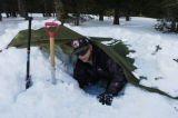(CAMERON PASS, hwy 14, Colo., December 14, 2004) Step 3 of a Snow Trench.  Don Davis, of...