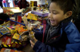 (Denver, Colo., Dec. 23, 2004)  Sammy Alvarez, age 7,was all smiles as he tried to make the choice...