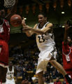 (Boulder, Colo. - December 23, 2004) -- University of Colorado Buffaloes Richard Roby, #23, passes...
