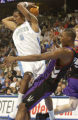 (DENVER , Colo, November 17, 2004) Nuggets  Rodney White drives against  Chris Bosh  in the 4th,...