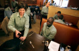(DENVER, Co., SHOT 11/17/2004) Rioja server Michelle Colarelli (left) of Denver pretends to grate...
