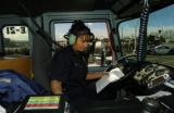(DENVER Colo., December 9, 2004) Evergreen fire fighter Shaina Lee follows the script in a mock...
