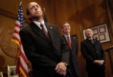 (DENVER, CO. DECEMBER 9, 2004) U.S. Attorney of Colorado John Suthers, left, flanked by Governor...
