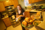 [(Denver, CO, Shot on: 12/24/04)] Claudia Gomez, 32, prepares a traditional mexican meal including...