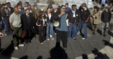 (Denver, Colo., December 10, 2004)  A rally on Friday (12-10-04) at  the Wellington Webb Municipal...
