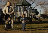 (GREELEY, Colo., December 10, 2004) Karen Traxler, 37,  plays with her boys Joey, 22 months,...