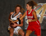 Littleton, Colo., photo taken Dec. 10, 2004-Arapahoe's Kate Denning (left white #50) protects the...