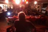 [Denver, CO - Shot on: 12/17/04]  Danny Daniels plays an acoustic melody to a quaint crowd at the...