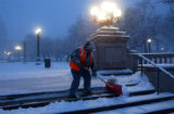 (DENVER, Colo., January 12, 2004) John Leon of Denver Park and Recreation, shovels the steps at...