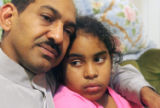 NYT25 - (NYT25) NEW YORK -- Nov. 23, 2004 -- PARENTS-DEPORT -- Virginia Feliz, with her father,...