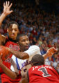 KSOW106 - Kansas guard Keith Langford (5) works between Saint Joseph's defenders Abdulai Jalloh...