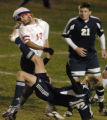 (ARVADA., NOVEMBER 9, 2004)  Liberty's captain, #17, Mason Bragg, left, nearly catches a boot in...