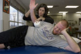 SPECIAL TO THE ROCKY MOUNTAIN NEWS- Physical therapist assistant Deb McEvoy works with Rockies'...
