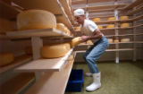 [(Durango, CO, Shot on: 11/23/04)]  Dan James works through the daily routine of turning cheese...