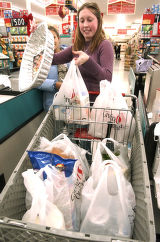 (Denver, Co.,  Nov.  24, 2004) Kasey Chertack finishes up shopping for her first Thanksgiving...