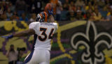 Denver Broncos running Reuben Droughns holds the ball over his head as he crosses the goal line...