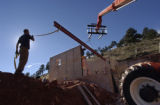 (Boulder, Colo., November 5, 2005) HGTV DREAM HOUSE PROJECT.  Christopher Herr, left, helps with...