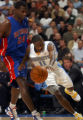 Denver, Colo., photo taken November 12, 2004-Denver Nuggets guard Earl Boykins, right, makes his...