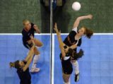 (DENVER, CO., NOVEMBER 12, 2004)  Lewis-Palmer's #13, Bryanna Burns, top/right, leaps up for a...