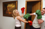 (Vernal, Utah) Jonathan Swain, 21, and his wife, Amber, play fight at their home in Vernal, Utah....
