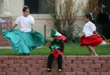 Jose Bencomo (cq) (accent over e in Jose), 5, center, waves a Mexican flag while his sisters...