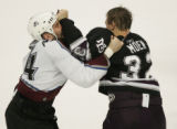 JPM593   The Mighty Ducks of Anaheim Travis Moen, #32 fights Colorado Avalanche Ian Laperriere at...