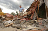 (Granby, CO, Shot on 060804) Ski-Hi Newspaper owner Bill Johnson walks through what remains of the...