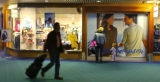 Airport passengers pass by Norm Thompson retail outlet at PDX  The company as a whole is possibly...