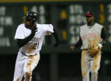 Choo Freeman heads to 3rd after stealing 2nd and went to 3rd when the ball got past second, in the...